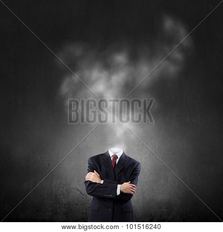 Headless businessman in black suit with arms crossed on chest