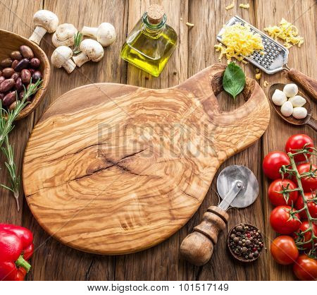 Pizza ingredients: mushrooms, olives, cheese and tomatoes.