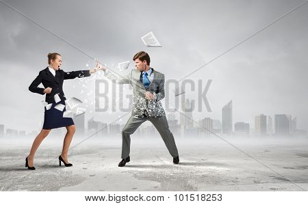 Two business people in anger fighting with each other