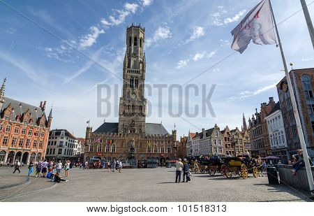 Bruges, Belgium - May 11, 2015: Tourist On Grote Markt Square In Bruges, Belgium