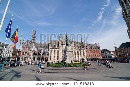 Bruges, Belgium - May 11, 2015: Tourist On Grote Markt Square In Bruges