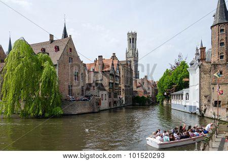 Bruges, Belgium - May 11, 2015: Tourist Visit Rozenhoedkaai In Bruges, Belgium.