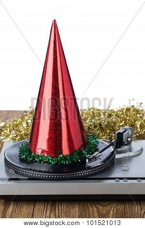 Shiny party hat on record player