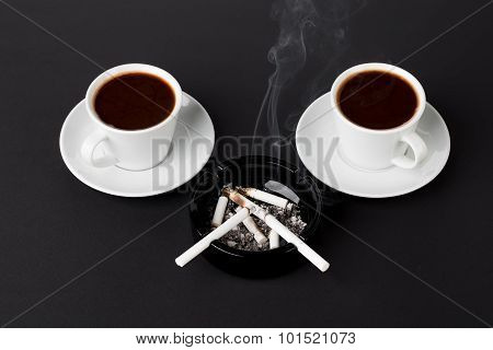 White cups of coffee with ashtray and cigarettes
