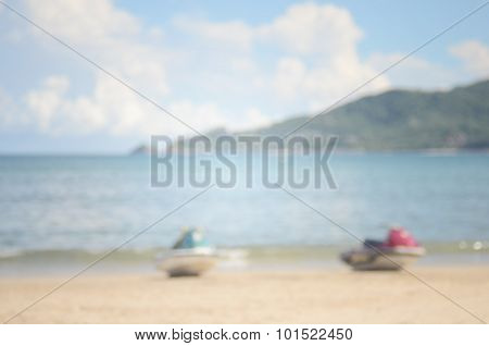 Beach background.Blurred jet ski on beach abstract background.