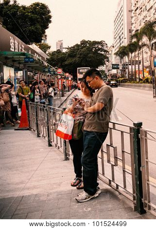 Young Asian couple with Cell phone.