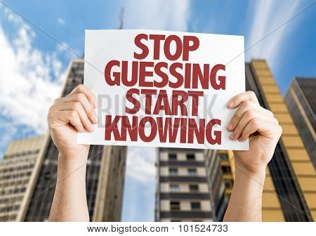 Stop Guessing Start Knowing placard with cityscape background