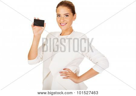 Young businesswoman shows business card.