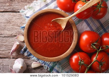 Tomato Sauce With Garlic And Basil In A Bowl Closeup. Horizontal Top View