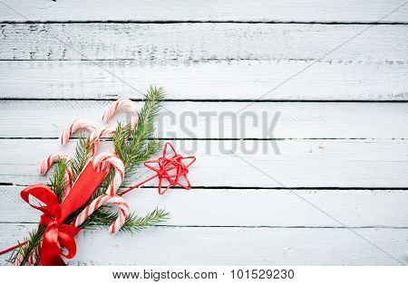 Christmas bouquet made up of candy canes, red star and conifer bound by red ribbon