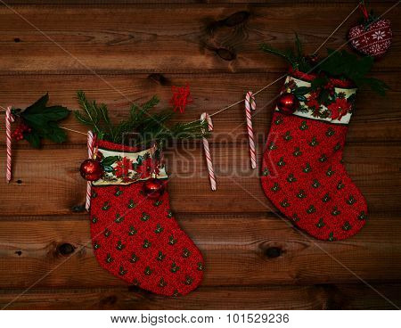 Christmas socks, sugar canes, toy bubbles and other decorations on wooden background