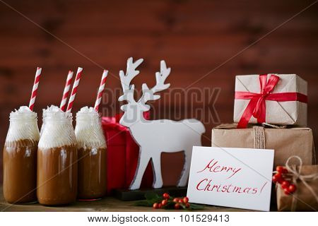 Toy deer, greeting card, hot chocolate with whipped cream and giftboxes