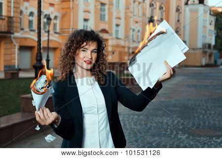 Girl Is Holding The Documents That Burn.