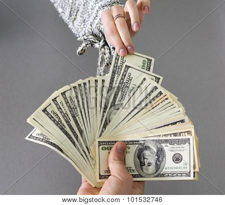 Picking cash note of the hands of husband