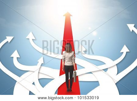 Concept of confused businesswoman with different direction arrows