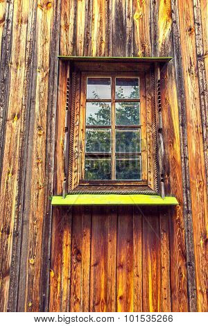 Carved Frame And Window In The Old Wooden House