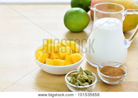 Mango lassi smoothie ingredients.