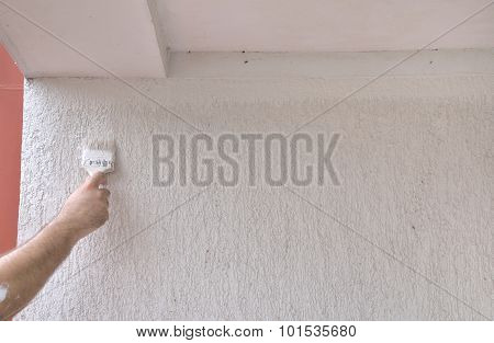 White Rough Wall With Painting Brush