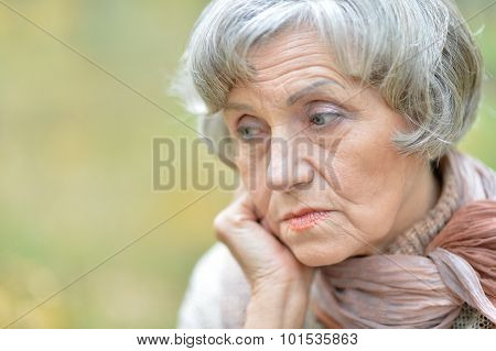 Thoughtful sad elderly woman