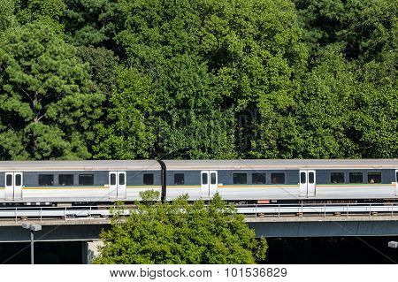 Commuter Rail Train In The Trees