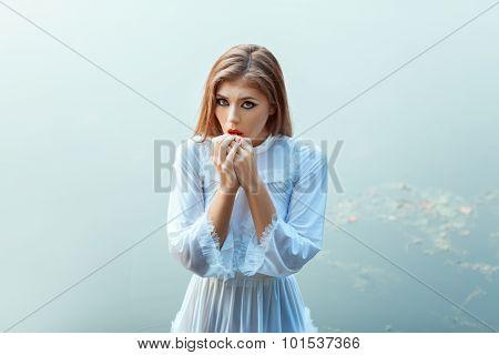 Strange Girl In A White Dress.