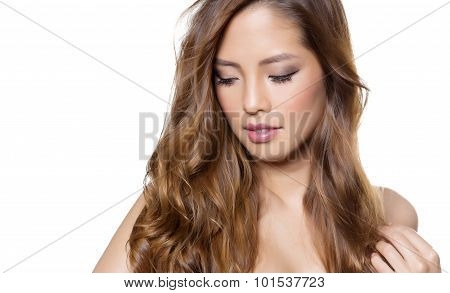 beautiful young asian woman with long hair and flawless skin