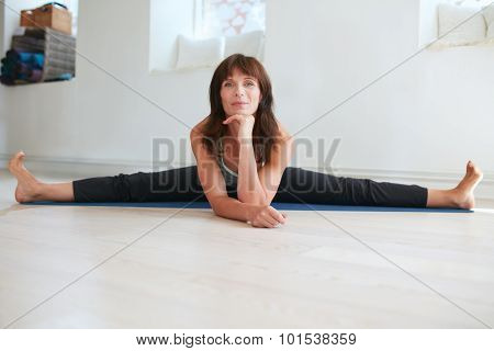 Woman Doing Wide Angle Seated Forward Bend Yoga
