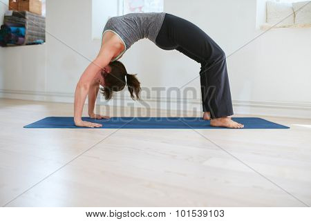 Woman Doing Yoga - Urdhva Dhanurasana Pose