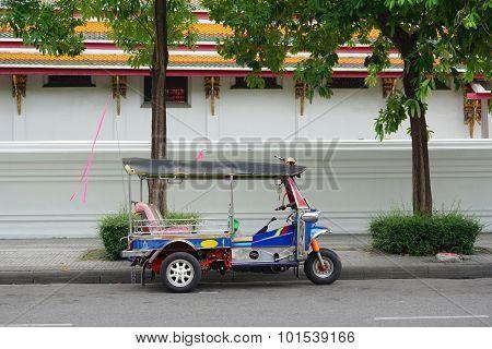 Traditional Tuk-tuk Awaits Passengers In Bangkok