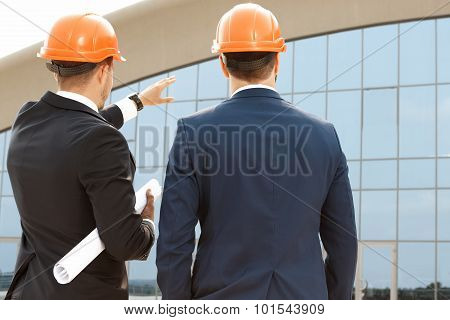 Two architect assessing their building progress