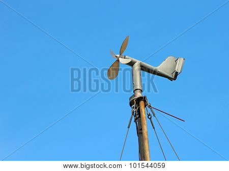 Vintage wind mill the background of blue sky