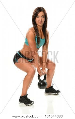 Young woman exercising with kettlebell weight isolated over white background