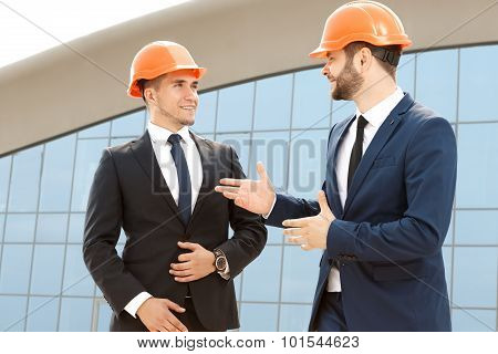 Two architect having conversation outdoors