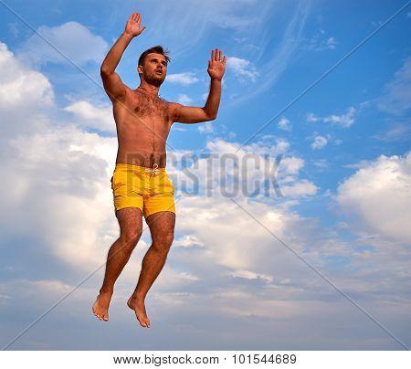 Flying Man Over Beautiful Sky