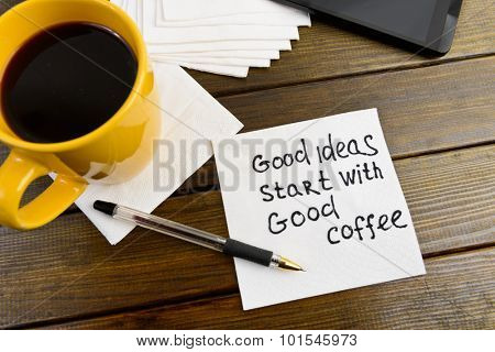 Super ideas start with good coffee -  handwriting on a napkin with a cup of coffee