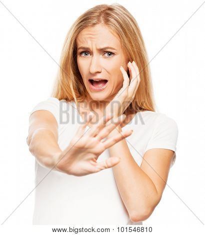 Woman at white background. Young frightened female isolated