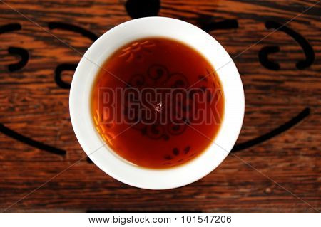 Chinese Black Puerh Tea In White Bowl On Wooden Tea Tray