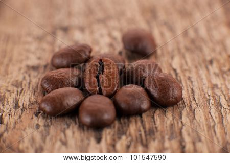 The Grains Of Coffee Or Mocha On Wood