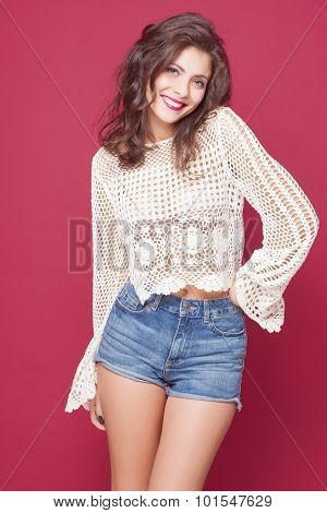 young happy beautiful girl posing grimacing in studio