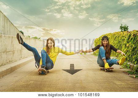 Skateboarder girlfriends roll down the