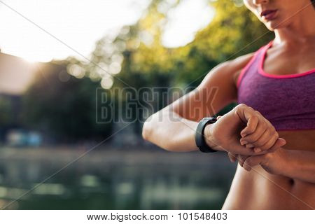 Woman Setting Up The Smartwatch For Running