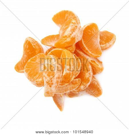 Pile of slice sections of tangerine isolated over the white background