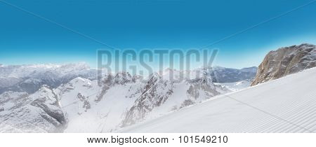 Alps panorama view in winter snow time with ski slope