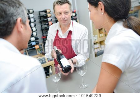 Waiter presenting a bottle of red wine