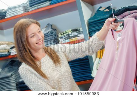 Lady choosing a jumper