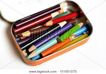 Tin bin of colored pencils representing creative art artistic creations