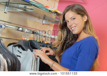 Lady browsing in clothes shop