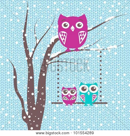 Christmas card with cute owls family, a branch with family of owls in winter time.