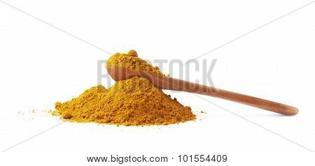 Spoon over the pile of curry powder