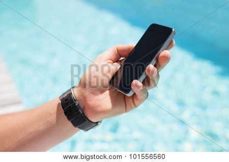 Man holding smartphone in hand
